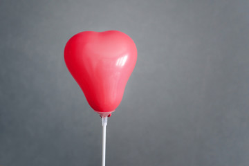 Valentine's day. A heart-shaped balloon. Love confession to a woman.