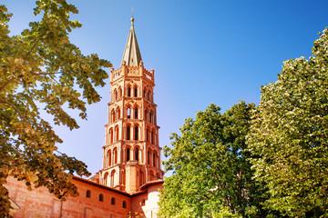 Saint-Sernin basilica steeple against blue sky