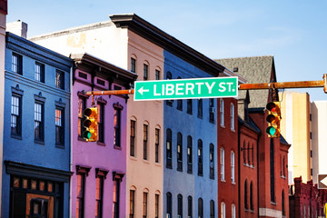 Guide sign at Baltimore street with colored houses