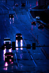 Rainstorm on Roadway with Cars Driving in Storm Street Lamps Headlights dark