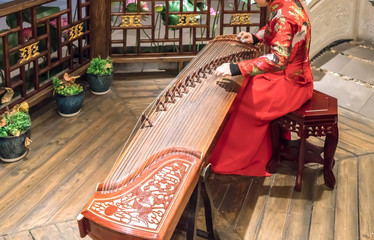 Women are playing zither, Chinese instruments