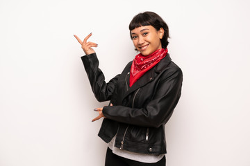 Woman with leather jacket and handkerchief extending hands to the side for inviting to come