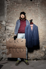 Jobless man with cardboard Work for food sign