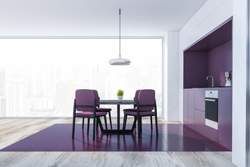Side view of purple kitchen with table