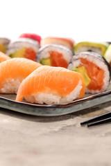 Foto op Aluminium Sushi bar close up of sashimi sushi set with chopsticks and soy - sushi roll with salmon and sushi roll with smoked eel