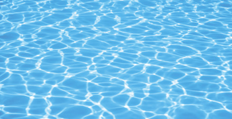 Blue ripped water in swimming pool background