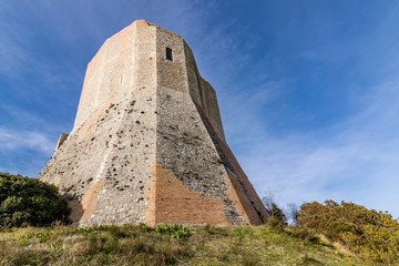 The imposing Rocca d'Orcia against a blue sky in the province of Siena, Tuscany, Italy