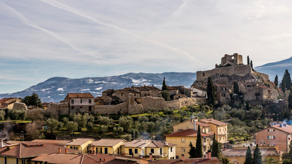 The medieval village of Castiglione d'Orcia against the snow-covered hills, Siena, Tuscany, Italy