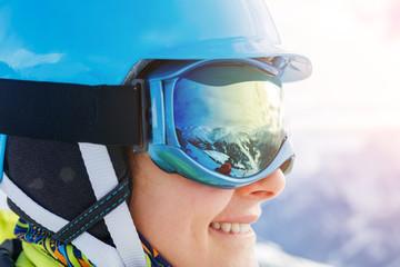Closeup portrait of Girl snowboarder in the winter ski resort.
