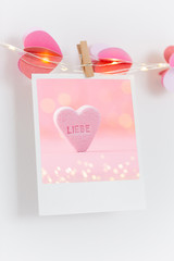Photo on white wall. Photography heart, vintage postcards and retro styles.