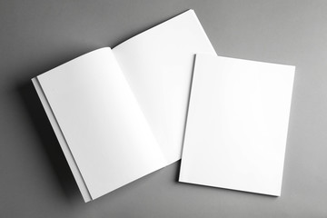 Open and closed blank brochures on grey background, top view. Mock up for design Wall mural