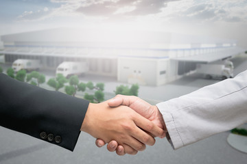 Handshake startup for warehouse construction agreement of logistics partners.