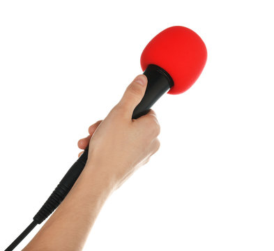 Woman holding microphone on white background, closeup