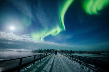 The Aurora Borealis (Northern Lights) is seen over the sky near Inari in Lapland
