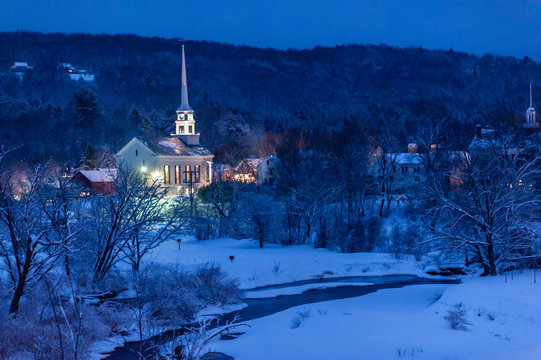 Community church at dusk during the winter, Stowe, Vermont, USA
