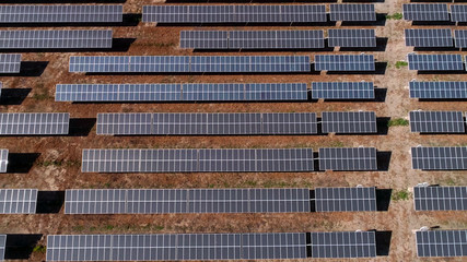 Aerial view of solar power plant in desert, United States. Solar panels field (solar cell) from above. Alternative energy, ecology power conservation concept. Drone Shot, Solar station