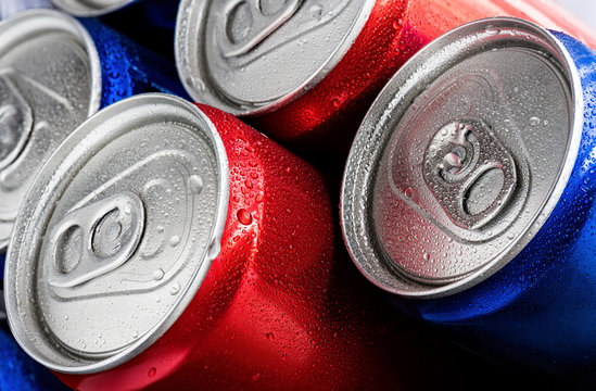 Wet cans of soft drinks