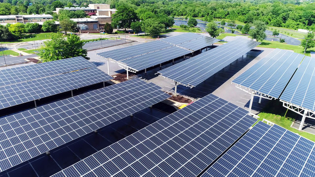 solar power in car station, Aerial view of solar paneled covered parking roof