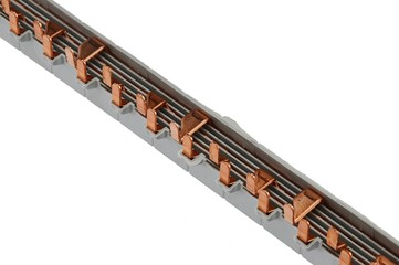Gray plastic electric terminal busbar with copper contacts, white background