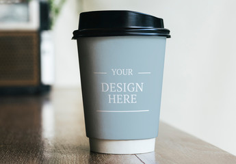 Paper Coffee Cup on Table Mockup