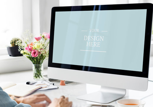 User at Desktop Computer with Flowers and Coffee Mockup