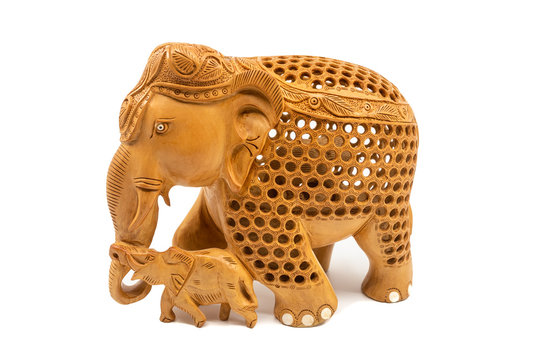 Traditional carved elephant mother and baby statue souvenir, isolated on a white background