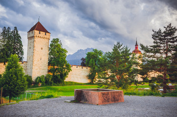Fototapete - Old city wall and towers in Luzern, Switzerland