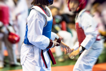 Moment of Taekwondo Kids in the stadiums. Athlete to strike an opponent during the tournament taekwondo kids. Add film filter and effect zoom for movement feeling.