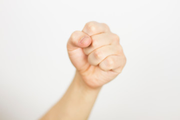 fist on white background - selective focus, blurred