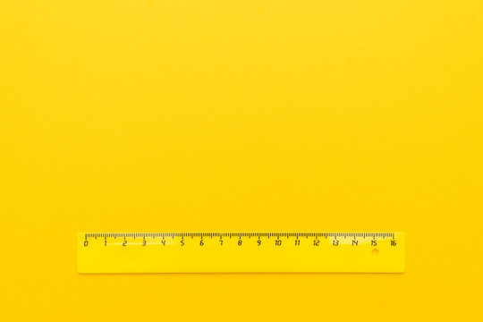 yellow plastic ruler on the yellow background