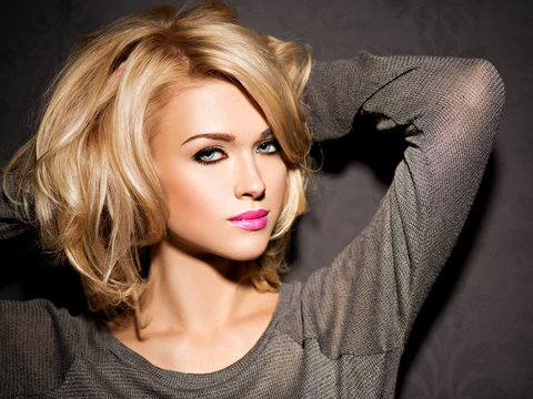 Portrait of  beautiful woman with blond hair.  bright fashion makeup