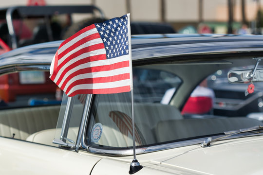 American flag on car aerial