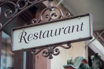closeup of vintage restaurant sign on building facade