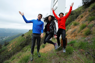 "Climber Honnold and ""Free Solo"" directors Chin and Vasarhelyi at Hollywood sign in Los Angeles"