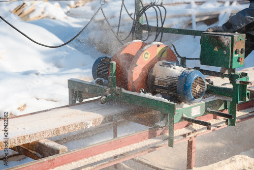 Sawing boards on the sawmill  Cook lumber in winter  Work on
