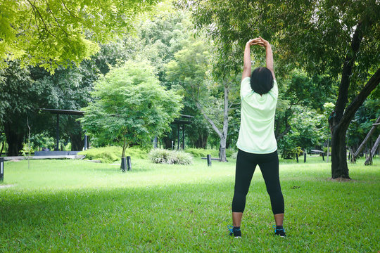 An Asian old woman exercising in the garden for good health.