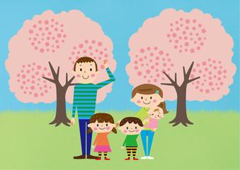 お花見で桜を楽しむ家族