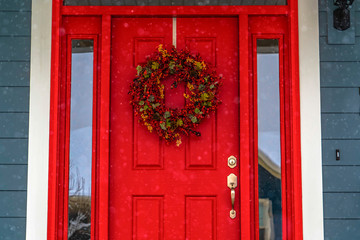 Red front door with wreath and glass panes in Utah Wall mural