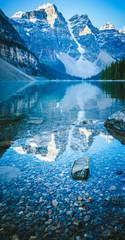 Mountain reflection - Moraine lake. Mirror image.