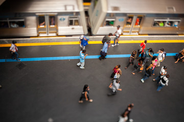 Mockup model style urban landscape - people on subway train platform - real tilt-shift TS lens