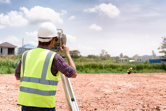 Surveyor equipment. Surveyor's telescope at construction site or Surveying for making contour plans are a graphical representation of the lay of the land before startup construction work