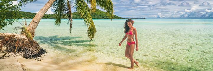 Wall Mural - Beach paradise background vacation travel in Luxury Bora Bora Tahiti French Polynesia bikini woman relaxing on idyllic landscape banner panorama.