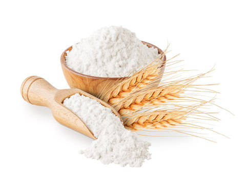 Whole grain wheat flour and ears isolated on white