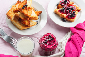 Delicious toasts bread with homemade currant jam with milk
