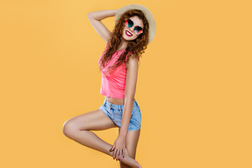 Attractive crazy girl dance in jeans shorts and sunglasses. Minimal pop art style.