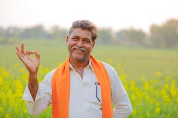 Indian farmer at black musterd field