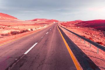 car road on a desert landscape