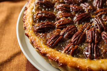 Plate with tasty pecan pie on table, closeup