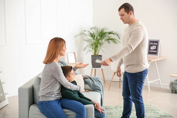 Man giving alimony to his ex-family at home