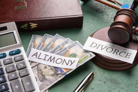 Composition with words ALIMONY and DIVORCE, money and calculator on color background